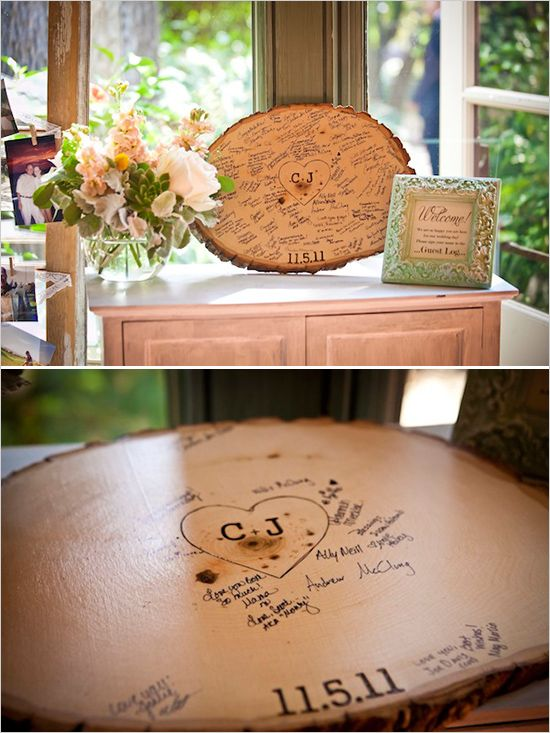 sign a tree stump instead of a guest book. Also love how they hung up pics on lace off to the side.