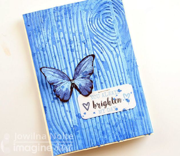 Brighten someone's day with a gorgeous Lapis blue butterfly card featuring Fireworks Shimmery Craft Spray and Memento Luxe. With the shimmer, lush blue pigment ink, dimension and texture on this card, you will spread joy around like a beautiful butterfly. Be inspired and inspire others with this gorgeous color and the thoughtfulness of a handmade encouragement card. Jowilna Nolte creates a lapis blue butterfly handmade card using Memento Luxe, Fireworks shimmer spray and a embossing folder.
