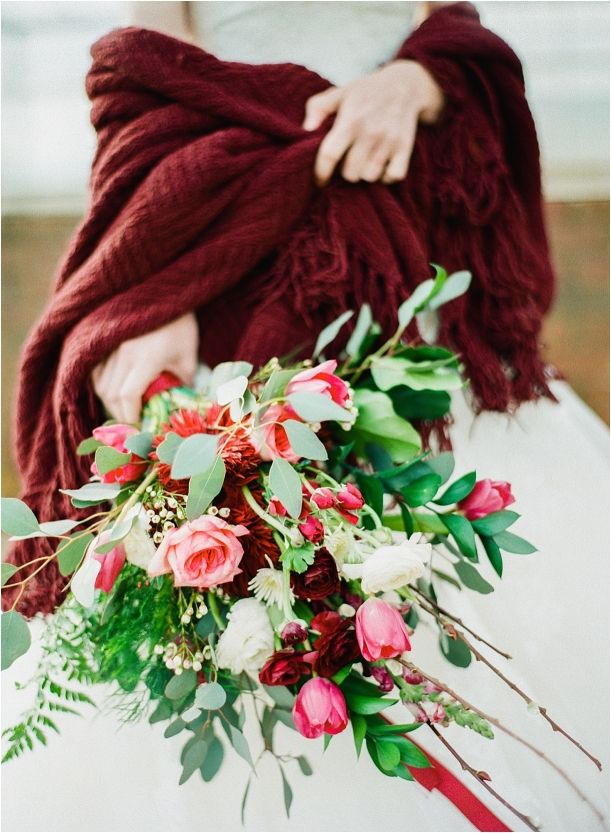 Marsala winter wrap with a beautiful marsala infused wedding bouquet