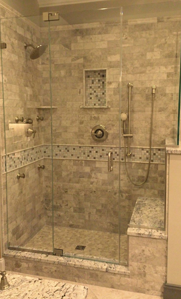Stone Tile Walk-In Shower Design | Kenwood Kitchens in Columbia, Maryland | Marble Tile Shower with Stone Mosaic | Walk-In Shower with Seated Bench