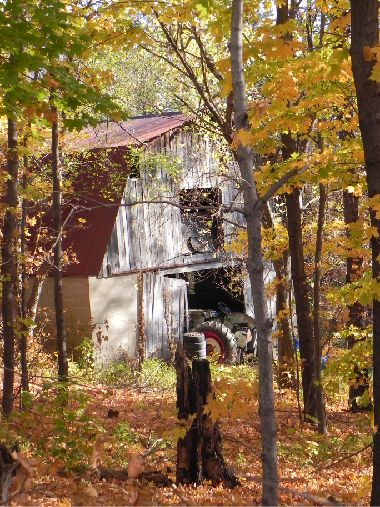 Old barn and tractor time gone by