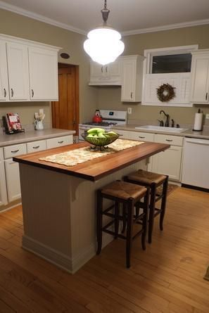 See how this reader used stock cabinets--trimmed, painted and topped with a wood counter--to create a custom DIY kitchen island.   thisoldhouse.com/yourTOH
