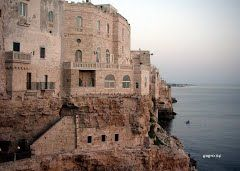 Hotel Grotta Palazzese in Polignano. Carved out of magnificent limestone rocks,with a view over the blue-green Adriatic.