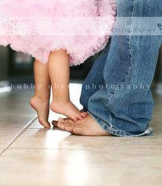 Take a picture of daughters on daddys feet as a infant/toddler. Do this every year, until the last one is at her wedding!!