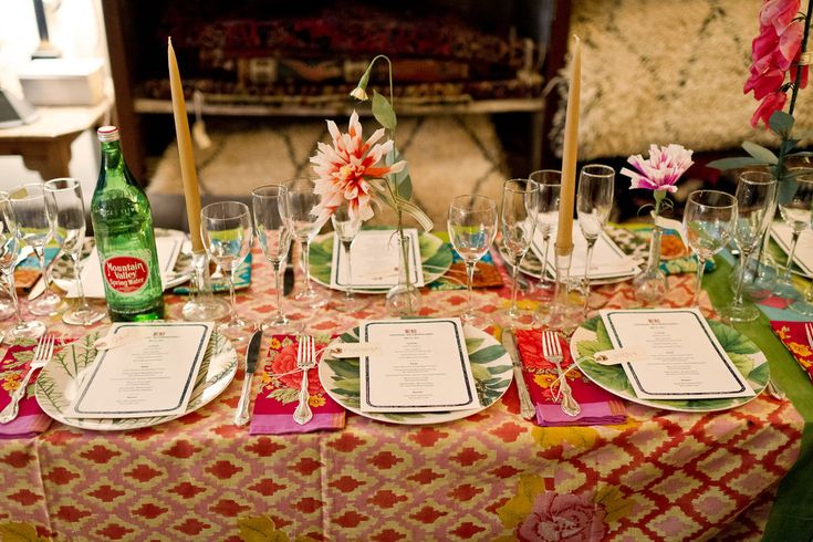 Derian set the table with linens by Lisa Corti, paper flowers by The Green Vase and melamine plates from his own Target collection. Photo: Mimi Ritzen Crawford