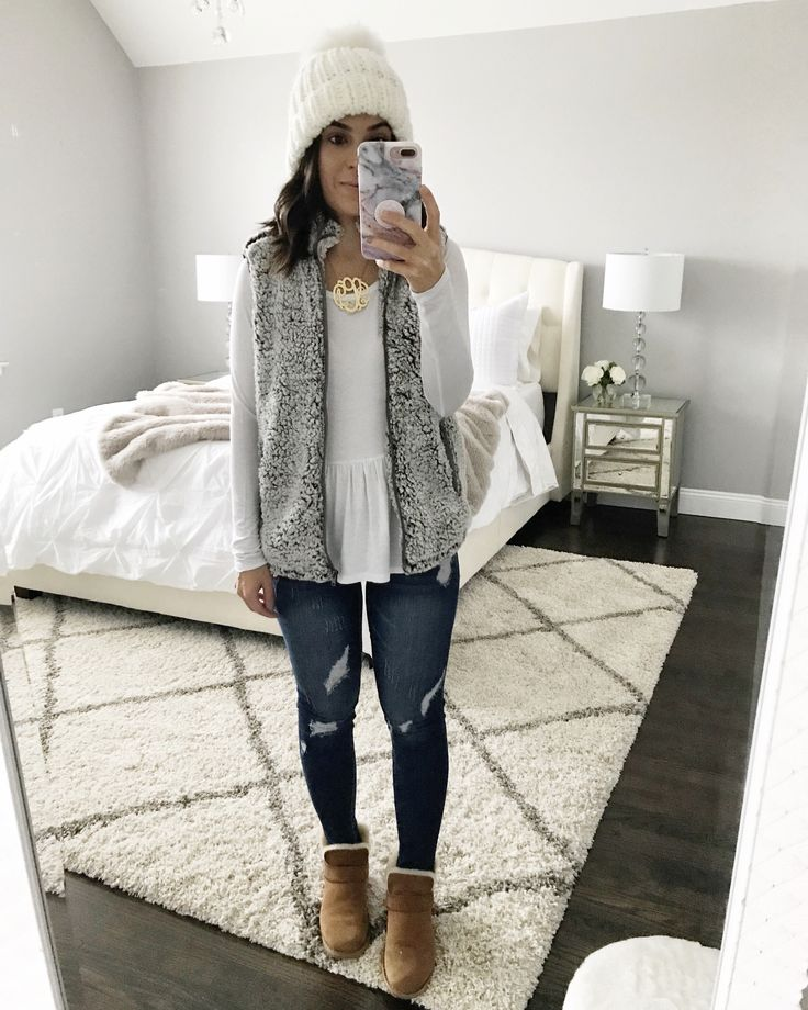 Cute Winter layers | Cozy gray fleece vest, white peplum top, distressed jeans, & UGG booties