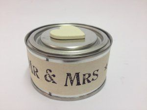 Mr & Mrs Candle Tin £8.99 East of India Mr and Mrs vanilla cream scented vintage candle tin. Each tin comes with a wooden heart on the lid 'Mr & Mrs' printed around the tin. Candle has a 14 hours burn time: Dimensions: Approx: H: 4.5cm x D: 7.5cm