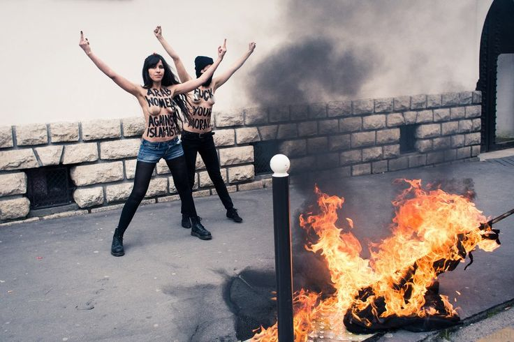 Lebanese girls burning ISIS flags topless.