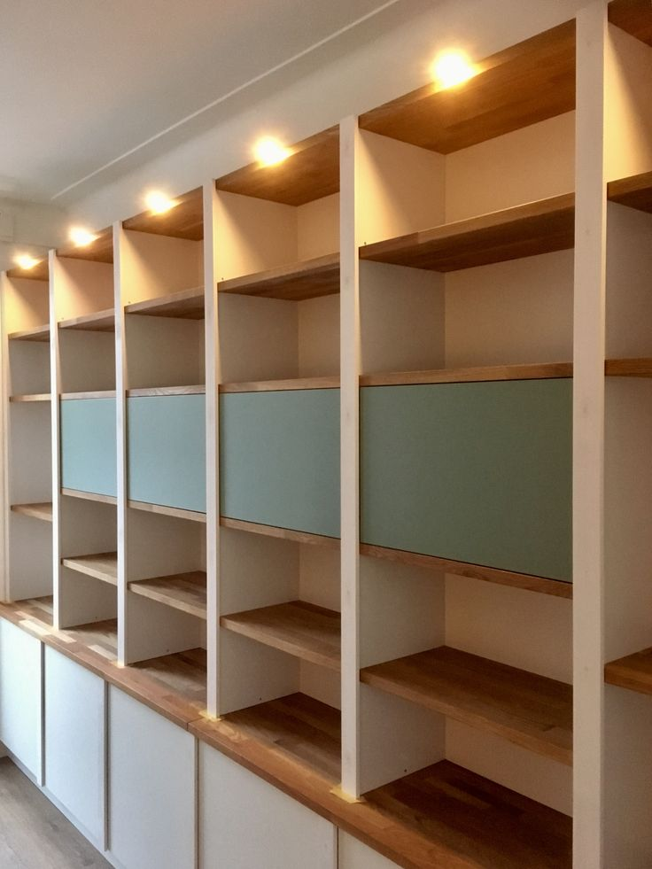 Custom fit cabinets with Oak shelving