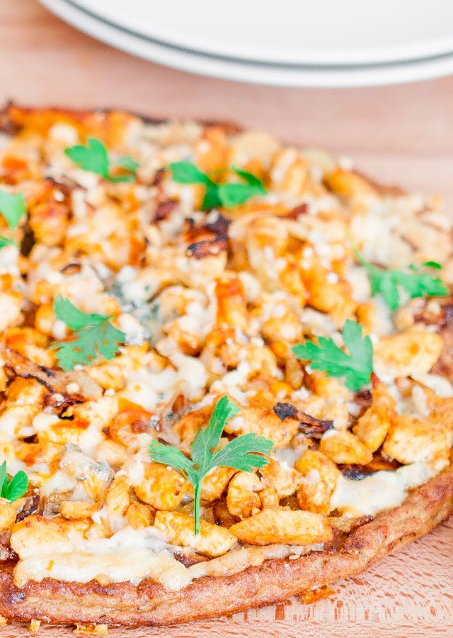 Buffalo Chicken and Caramelized Onions Pizza on Cauliflower Crust – a much healthier alternative to regular pizza by using a cauliflower pizza crust.