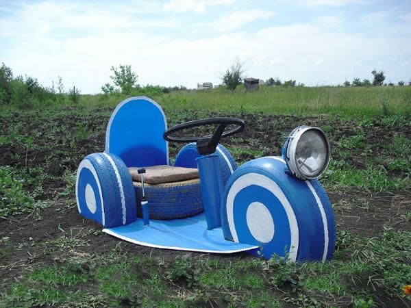 ways to recycle old car parts and tires for yard decorations