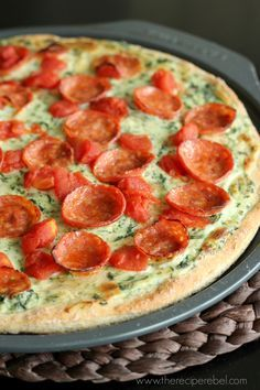 Pepperoni Florentine Pizza - Pesto spinach Alfredo sauce, tomatoes, pepperoni and mozzarella.