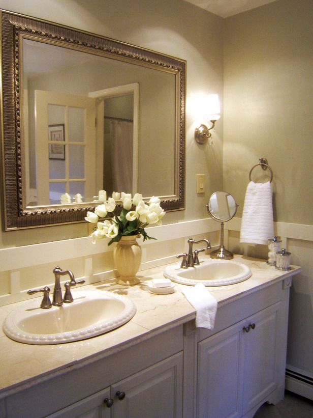 12 Bathrooms: Ideas You'll Love: This once-dingy bathroom was turned into an elegant space for less than $1,000. The homeowner used prefab cabinets, added molding and replaced hunter-green tile with marble. (Design by