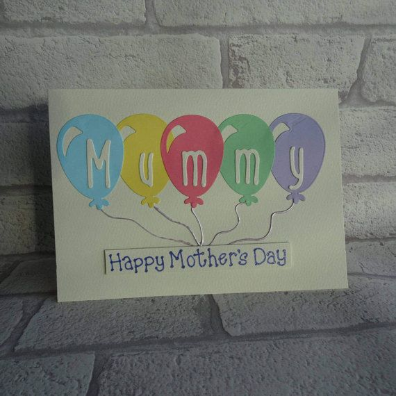 Card for Mummy: Mothers Day balloon card. Handmade card for Mommy with a bunch of balloons.  This Mothering Sunday card has a bunch of balloons in pastel colours (although you can choose alternative colours from the drop-down menu) and liquid pearls are used to make the strings attached to the balloons. The sentiment on this Happy Mothers Day card is added with 3D foam and reads: Happy Mothers Day. The message is added with metallic lilac glitter ink.  Mummy is added to the balloons and this…