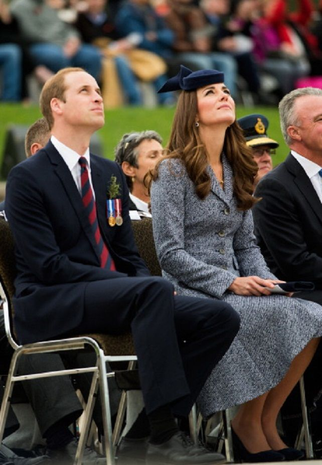 Prince William and Duchess Kate watch a flyby as they attend the 2014 ANZAC Day commemorative service at the Australian War Memorial in Canberra, Australia.