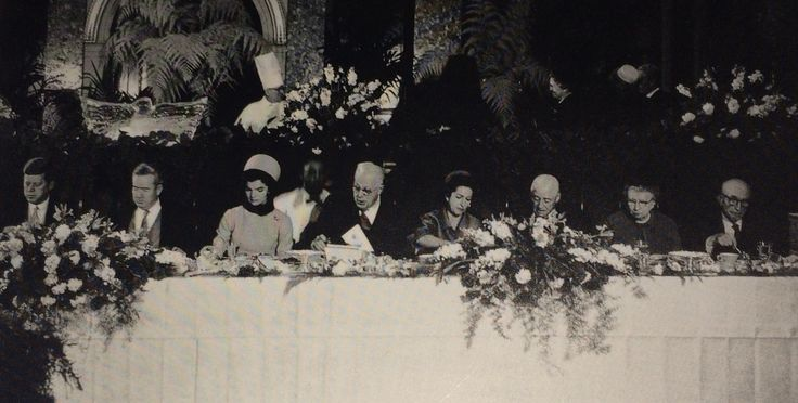 The inaugural luncheon for the new president. Between Jackie Kennedy and Lady Bird Johnson sits Chief Justice Earl Warren. Bess Truman is second from right and President Kennedy is at the far left.