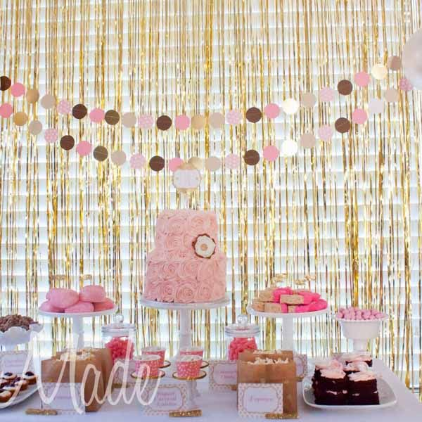 gold surtain backdrop for wedding dessert tables