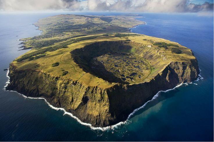 Rano Kau volcano in Rapa Nui National Park, Easter Island, Chile  http://i.imgur.com/NzfNy.jpg