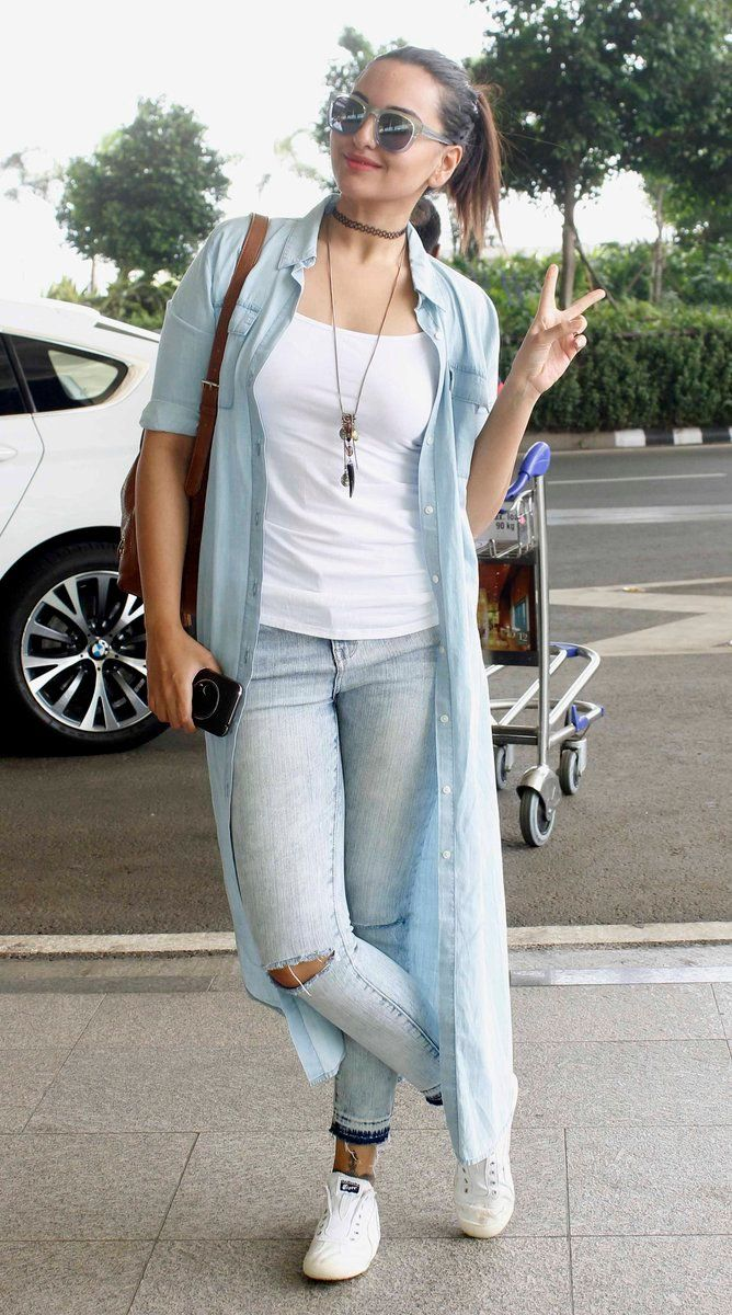 Glam Gal - Sonakshi Sinha Glam Point - Mumbai Airport Glam Check - A casual and laid back airport style with ripped blue denim, white tank top and a blue over-sized shirt-jacket. She finished the look with a black choker and a tan backpack! Glam Tip - Travel in style while keeping it comfy by pairing street style with white sneakers!  -Your Glam Pal, Srishti #sonakshisinha #airportstyle #casualstyle #streetstyle #whitesneakers #choker