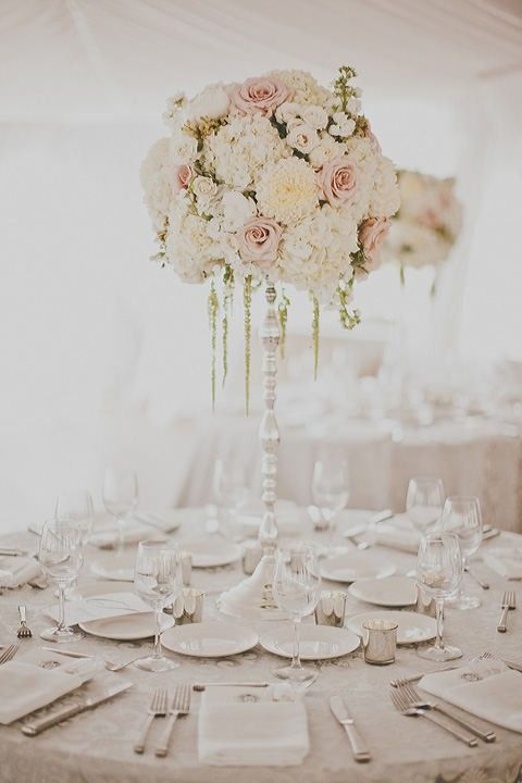 Pretty white and light pink theme for wedding reception.