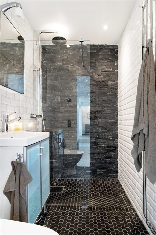 Walk in shower and natural grey stones.- Too dark for the small space, but I like the stone work on the wall- maybe a lighter color?
