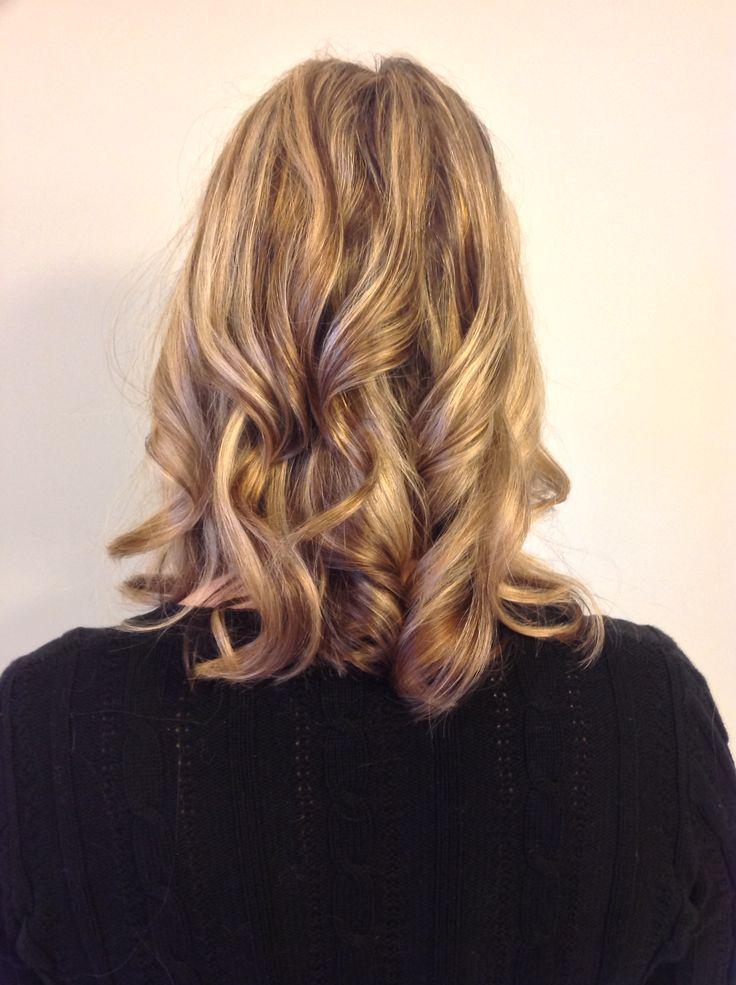 Blonde balayage highlighted hair, shoulder length curled