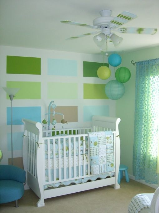 this baby could just sleep in my living room since it has paint sample squares all over it! cannot decide. love this room though.