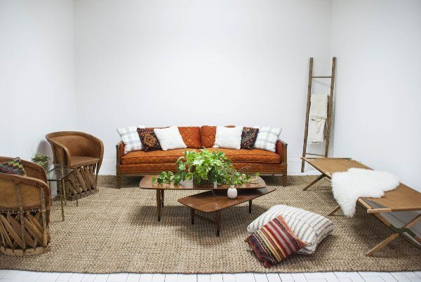 Cozy Bohemian Lounge with Bright Red Sofa, Mexican Chairs and Wood Ladder via Birch & Brass Vintage Rentals for Weddings and Corporate Events in Austin, TX