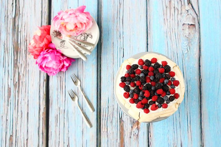 My first attempt at baking a Pavlova. All organic ingredients. Topped with coconut cream & berries. So yummy! #pavlova #foodphotography