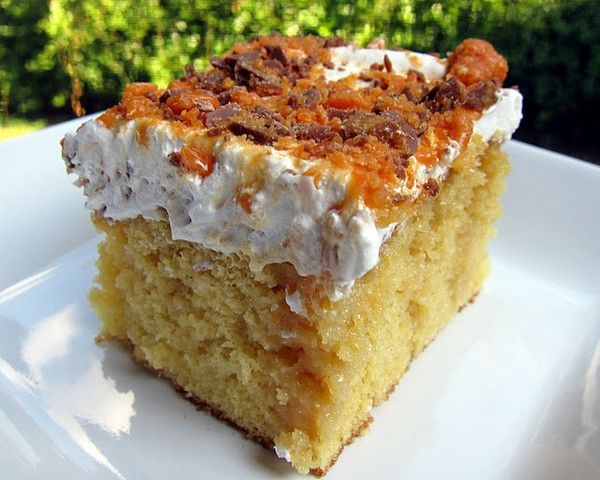 Bake a yellow cake, poke holes in it while still warm, pour a can of sweetened condensed milk over, then a jar of smuckers caramel ice cream topping. Cool, spread with Whipped Cream and sprinkle with crushed Butterfinger or Toffee.