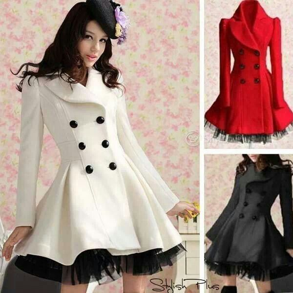 this is a white sack the how has six black buttons and an elongated neck and silky waves in the bottom.