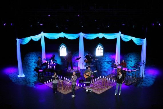 It's not difficult to create a magical stage space. This looks was achieved by using fabric, windows, and some well-placed LEDs. (Source: churchstagedesignideas.com)
