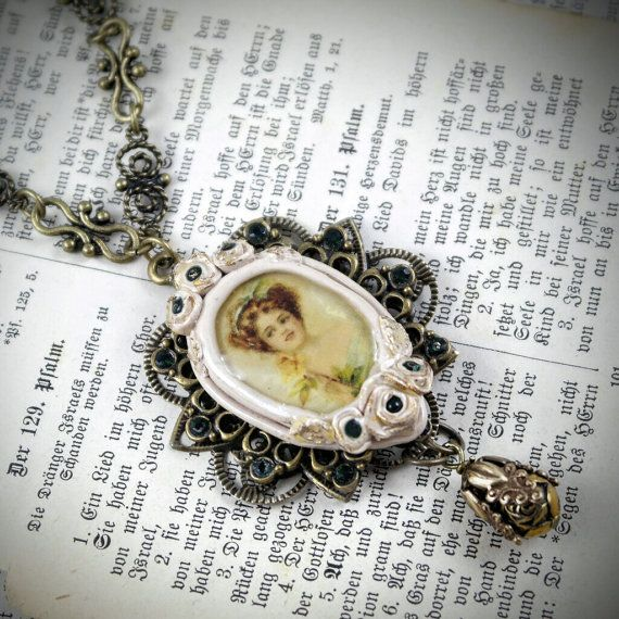 This unique beige victorian necklace vintage style pendant is made of polymer clay, glued to metal f