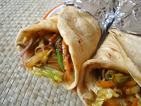 Many a night, our dinner comprises of either soup, salad, wrap or sandwich. Last night I made Kati rolls with vegetable filling. Works great as a lunch box treat, one that you kid will surely relish. Makes for a complete meal and super easy to bring together.