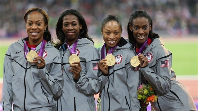 Gold medallists DeeDee Trotter, Allyson Felix, Francena McCorory and Sanya Richards-Ross of the United States pose