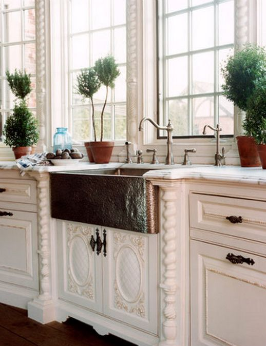 Great copper sink. Lovely cabinetry and trim.