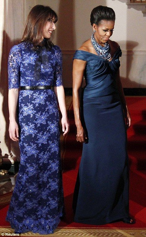 U.S. first lady Michelle Obama and Samantha Cameron, wife of British Prime Minister David Cameron,