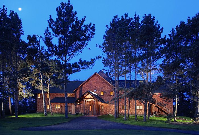 Nestled among pines and redwoods, The Brewery Gulch Inn in Mendocino, California overlooks Smuggler's Cove and the Pacific Ocean. The retreat gives cottage vibes at a cathedral size, and it's perfect for a wedding away.