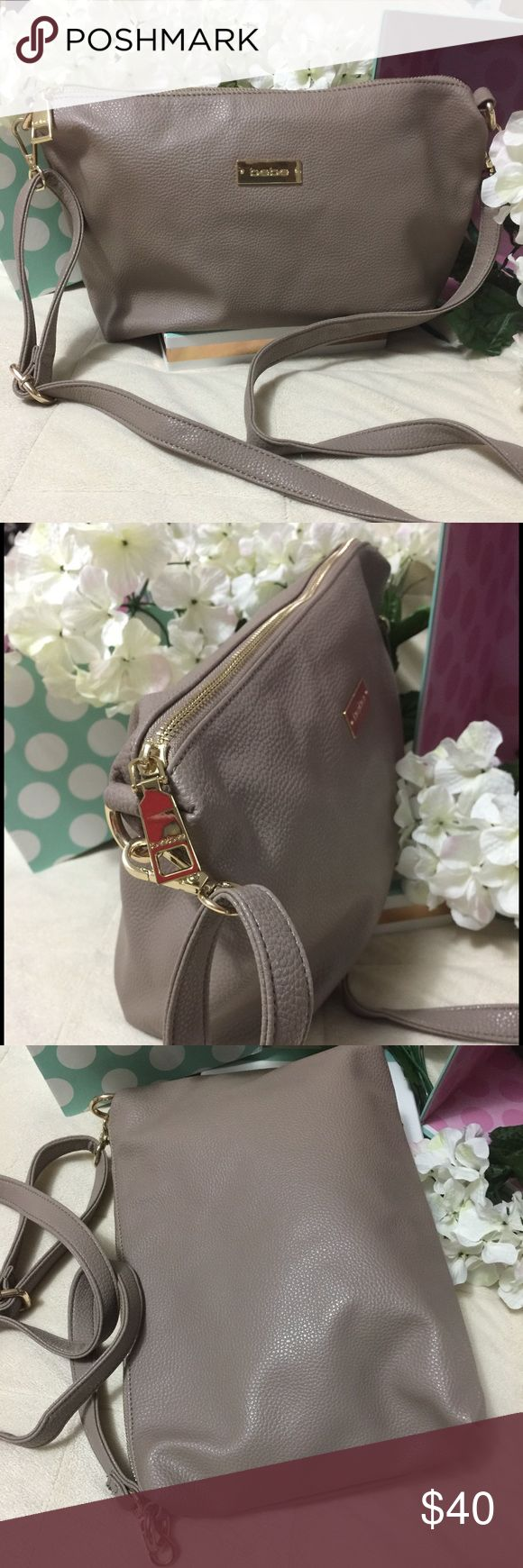 """NWOT Bebe Purse/Crossbody Beige Bag NWOT only took tags off.   Gorgeous cream/tan 13"""" x 9"""" Purse that can be worn over the shoulder, as a crossbody, or as a underarm/tote purse for an evening out.   Has Detachable/Adjustable straps. bebe Bags Crossbody Bags"""