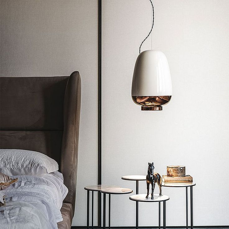 Elegant trio of contemporary pendants deliver textural and geometric contrast