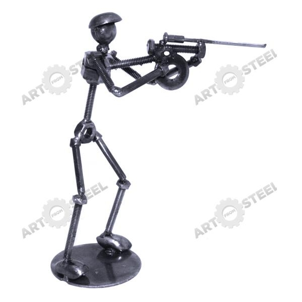 Made from scrap metal materials, this shooter adapts the classic stance when firing a rifle. With the rifle's stock braced firmly on the shoulder, this stance promotes accuracy in shooting. Several rifle shooting sports are also Olympic-sanctioned. During the Olympics, shooters from all around the world compete to become the best rifleman.  $14.99