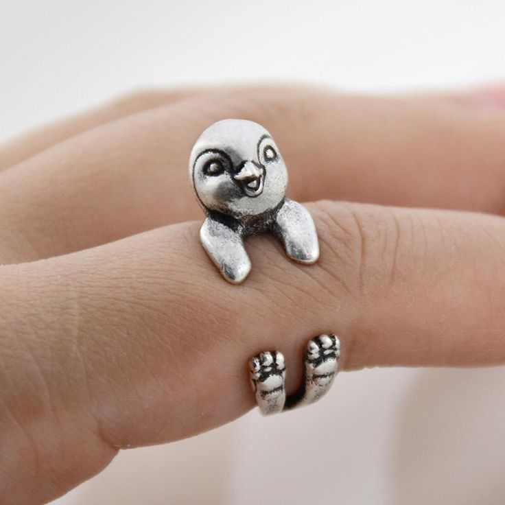 This ring is made inthe shape of a penguin that wraps around your finger. They are one size fits all and are platedin silver. This is perfect for anyone looki