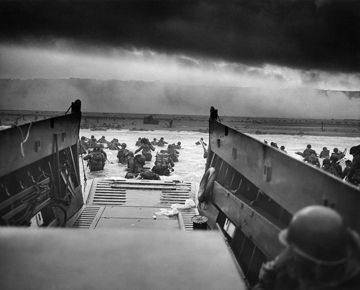 U.S. Army troops wade ashore on Omaha Beach on the morning of June 6, 1944.