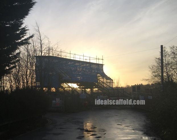 Construction work by twilight.  Ideal Scaffolding provide scaffolds towers and scaffold platforms to give others access to hard to reach areas in and around the rail infrastructure including stations, offices, buildings, bridges and tunnels.