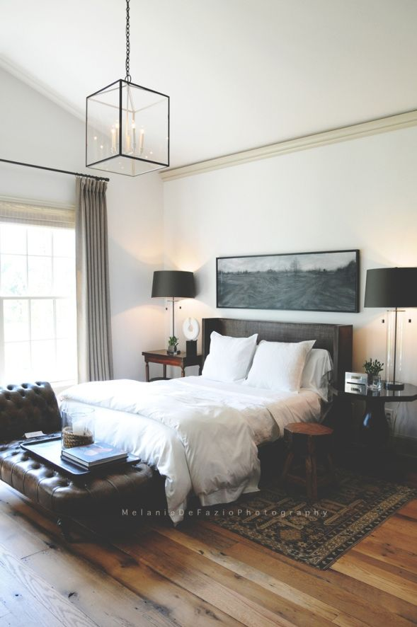 Two things that made this room masculine: that beautifully textured rug and the upholstery. The white bedding linen works in a room full of textures (wood, carpet, etc), whereas a colorful sheet works best in a minimalistic surrounding.