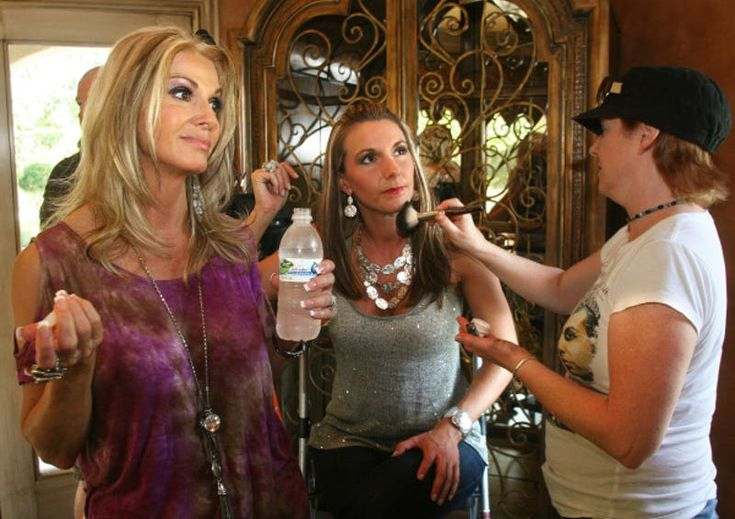 "Makeup artist Cheslea Lee (right) applies makeup to Ashley Moss during a break in the filming of ""Donna Decorates Dallas."" Host Donna Moss is on the left."