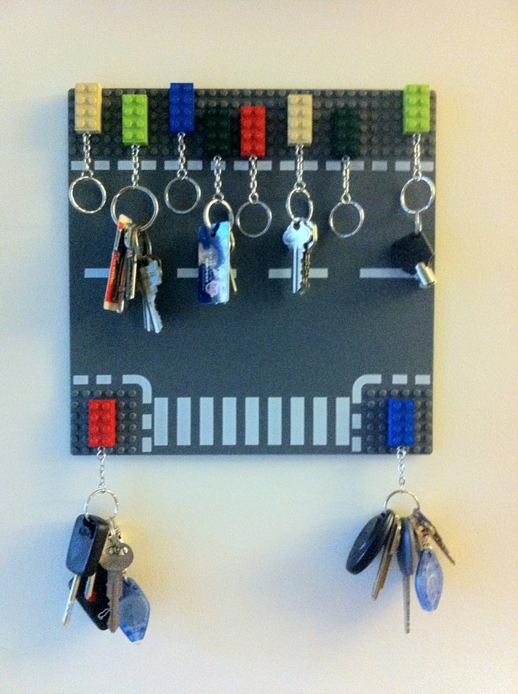 Lego board and lego blocks. Key ring holder. My amazing husband made this after I suggested it. It works wonders.