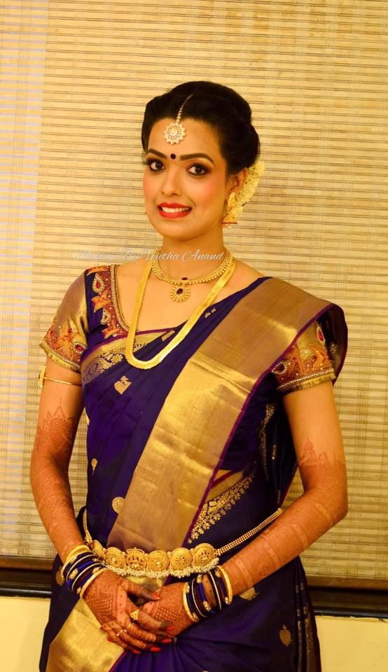 Aparna looks like a vision for her muhurtam. Makeup and hairstyle by Vejetha for Swank Studio. Pink lips. Bridal jewelry. Bridal hair. Silk sari. Bridal Saree Blouse Design. Indian Bridal Makeup. Indian Bride. Gold Jewellery. Statement Blouse. Tamil bride. Telugu bride. Kannada bride. Hindu bride. Malayalee bride. Find us at https://www.facebook.com/SwankStudioBangalore