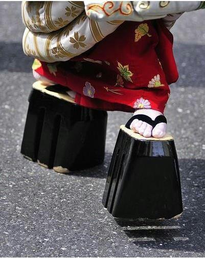 "Maiko (geisha in training) wear distinctive tall geta (geisha shoes) called ""okobo"""