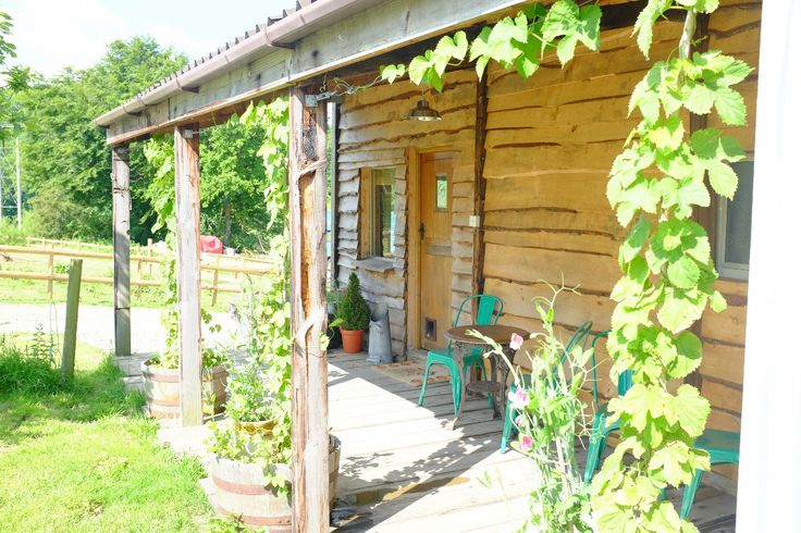 The Hop Shack, Penybanc Farm, Carmarthenshire. An upcycled static caravan clad in local timber and recycled corrugated tin, with second hand insulation in the walls, floor and ceiling http://www.organicholidays.com/at/3428.htm